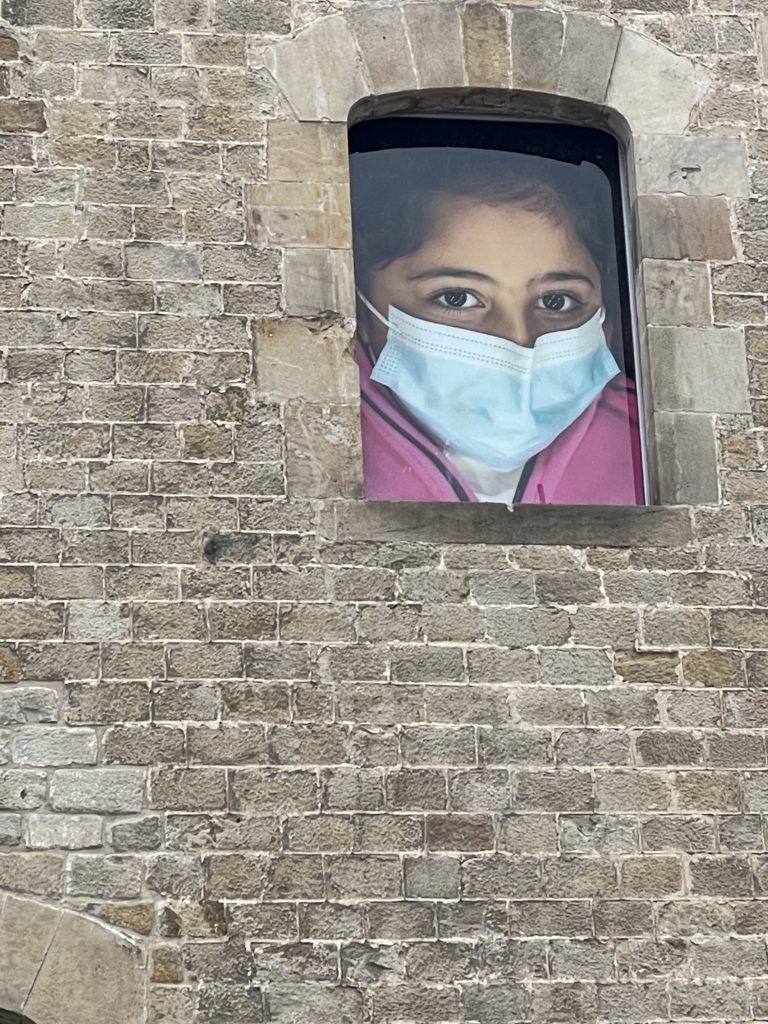 Walled Refugee Girl