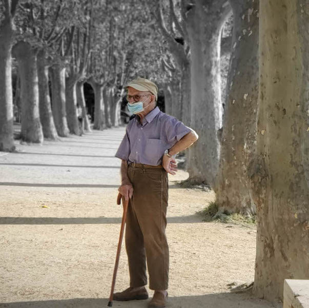 Puzzled Old Man With Cane